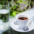 White espresso cup standing on the glass table — Stock Photo