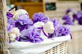 Violet and white packets with lavender flowers — Stock Photo