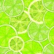 Bright seamless background with limes — Stock Vector