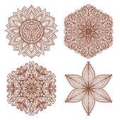 Set of four ethnic mehandi ornaments — Stock Vector