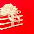 Royalty-Free Stock Photo: Red and White Striped Gift with White Ribbons