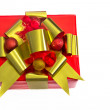 Red-Wrapped Holiday  Gift with Gold Ribbon — Stock Photo