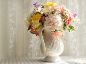 White Pitcher with Flowers — Stock Photo