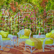 Stock Photo: Patio with Wicker Furniture and Trellis