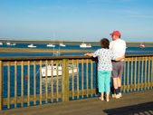 A Woman and Man Watching Boats — Stock Photo