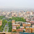 Stock Photo: YEREVAN, ARMENIA, JUNE, 23: City Yerevan, mountain ridge of Caucasus,Armenion June,23,2012. View of Operand Ballet Theatre, avenue and buildings