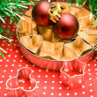 Pastry cutters and christmas balls — Stock Photo