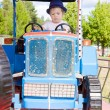 Stock Photo: Little Farmer on Tractor