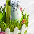 Bottle of milk in decorative basket with flowers — Stock Photo #31019743