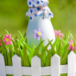Bottle of milk in decorative basket with flowers — Stock Photo #31019953