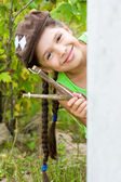 Girl with slingshot — Stock Photo