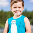 Smiling boy with bottle of milk — Stock Photo