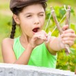Stock Photo: Girl with slingshot