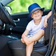 Cute barefoot driver in car — Stock Photo