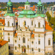 Saint Nicholas Church, Old Town Square, Prague, Czech Republic. View from Ctiy Hall in autumn — Stock Photo
