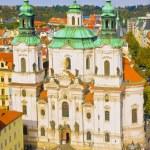 Saint Nicholas Church, Old Town Square, Prague, Czech Republic. View from Ctiy Hall in autumn — Stock Photo #35775303
