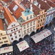 Stock Photo: PRAGUA, CZECH REPUBLIC- October, 10: Tourists on Old Town Square in center, Prague, Czech republic on October,10,2013. One of main attractions of Prague