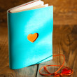 Stock Photo: Blue book with red heart
