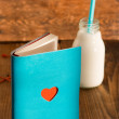 Stock Photo: Notebook and bottle of milk with heart
