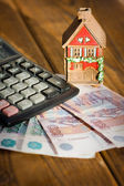 House with calculator and russian money — Stock Photo