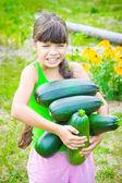 Girl hold raw zucchini — Stock Photo