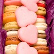 French colorful macarons with hearts in box — Stock Photo