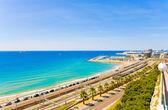 View of the coast Tarragona: sea, railway and petrochemical plant — Stock Photo