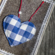 Small handmade heart on grey felt — Stock Photo #13611052