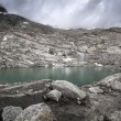 Small mountain lake in the north italian alps — Stock Photo