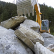 Excavator with big rocks — Stock Photo