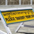 Sign asking to take off shoes at Shanti Stupa, Ladakh — Stock Photo