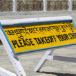 Sign asking to take off shoes at Shanti Stupa, Ladakh - Stock Photo