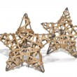 图库照片: Hand made straw stars as christmas decoration