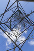 Electrical tower closeup against blue sky — Stock Photo