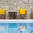 Swimming Pool with chairs and table — Stock Photo
