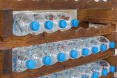 Plastic water bottles in a shelf — Stock Photo