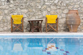 Swimming Pool with chairs and table — ストック写真