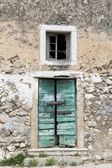 Door of an abandoned house in Greece — Stock Photo