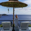 Stock Photo: Sun beds under umbrellin Greece with seview