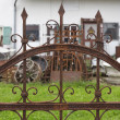 Rusted wrought iron fence — Stock Photo #34809701