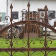Stock Photo: Rusted wrought iron fence