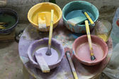 Paint pots seen in a pottery in Morocco — Stock Photo