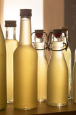 Bottles filled with elderflower syrup against the light — Fotografia Stock