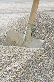 Shovel in a heap of grit — Stock Photo