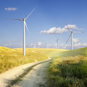 Windmills and the road — Stock Photo