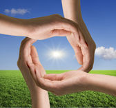 Circle of hands against blue sky — Stock Photo