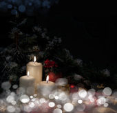 Christmas tree with candles in the snow — Stock Photo