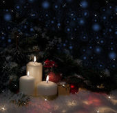 Christmas tree with candles in the snow — Stockfoto
