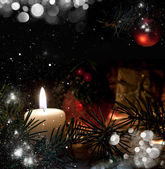 Christmas still life with snow candles and christmas decorations — Stock Photo