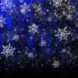 Photo: Bright Christmas background with a large snowflake